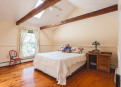 Charming Cathedral ceiling and wood floors throughout