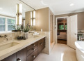Completely renovated Master Bathroom has Botticino Marble counters and heated floors