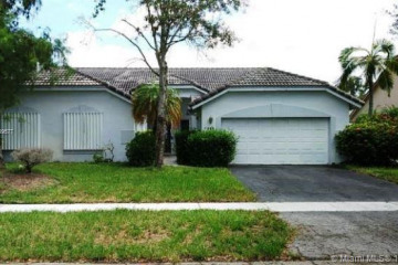 Home for Sale at 7395 NW 54th St, Lauderhill FL 33319