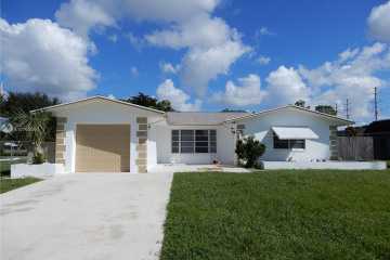 Home for Sale at 212 Sandpiper Ave, Royal Palm Beach FL 33411