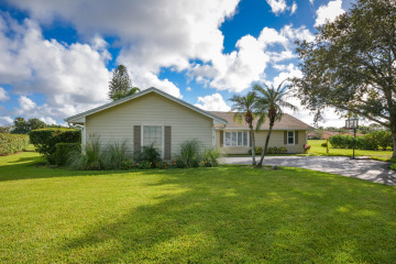 Home for Sale at 3530 SW Racquet Club Way, Palm City FL 34990