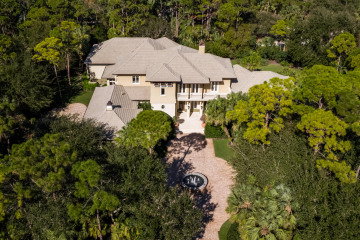 Home for Sale at 110 Bears Club Drive, Jupiter FL 33477