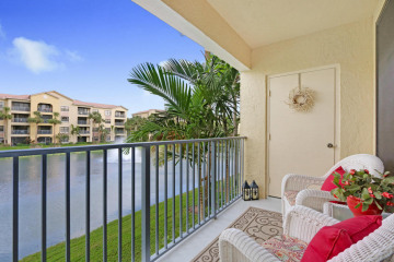 Home for Sale at 400 Uno Lago #202, Juno Beach FL 33408