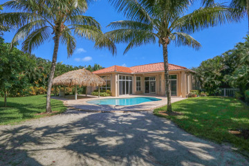 Home for Sale at 9942 SE Osprey Pointe Drive, Hobe Sound FL 33455