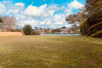 Home for Sale at 19 Country Club Circl, Tequesta FL 33469