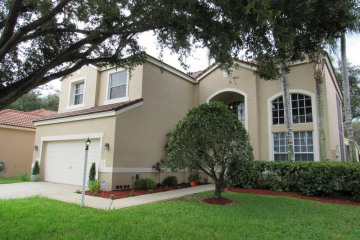 Home for Sale at 6302 NW 78th Place, Parkland FL 33067