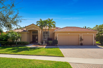 Home for Sale at 9811 SE Osprey Pointe Drive, Hobe Sound FL 33455