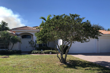 Home for Sale at 9978 SE Osprey Pointe Drive, Hobe Sound FL 33455
