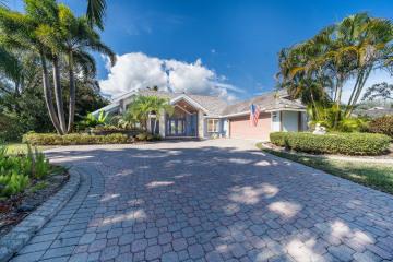 Home for Sale at 18510 SE Lakeside Drive, Tequesta FL 33469
