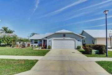Home for Sale at 6699 SE Silverbell Avenue, Stuart FL 34997