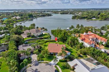 Home for Sale at 141 Pine Hill Trail W, Tequesta FL 33469