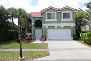 Home for Sale at 6361 NW 58th Way, Parkland FL 33067