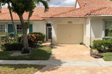 Home for Sale at 6169 Lake Hibiscus Drive, Delray Beach FL 33484