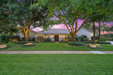 Home for Sale at 11905 Lake Shore Place, North Palm Beach FL 33408
