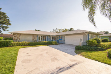 Home for Sale at 9842 SE Little Club Way S, Tequesta FL 33469
