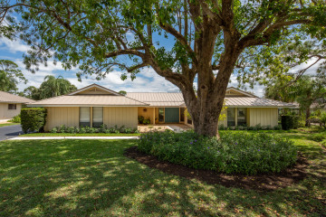 Home for Sale at 5640 SE Winged Foot Drive, Stuart FL 34997