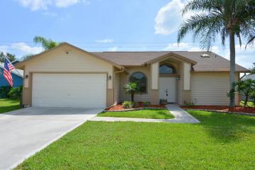 Home for Sale at 6655 SE Raintree Avenue, Stuart FL 34997