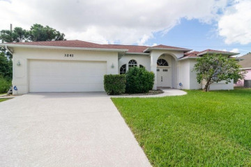 Home for Sale at 3241 SE Quay Street, Port Saint Lucie FL 34984