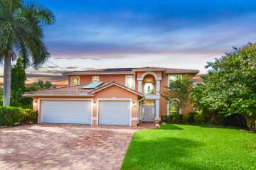 Home for Sale at 8401 SE Royal Street, Hobe Sound FL 33455