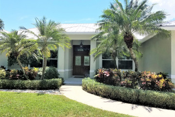Home for Sale at 24 Country Club Circle, Tequesta FL 33469