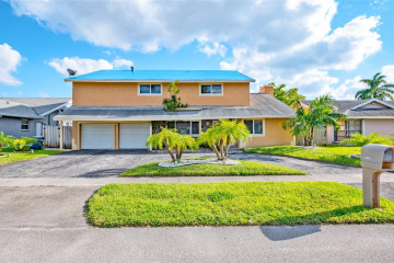 Home for Sale at 7180 NW 47 Place, Lauderhill FL 33319