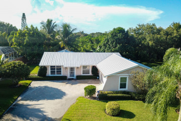 Home for Sale at 8761 SE Sandcastle Circle, Hobe Sound FL 33455
