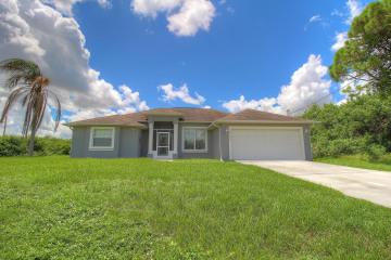 Home for Sale at 6140 NW Hopkins Avenue, Port Saint Lucie FL 34986