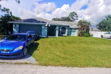 Home for Sale at 1721 SW Ocean Cove Avenue, Port Saint Lucie FL 34953