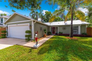 Home for Sale at 6613 SE Amyris Court, Stuart FL 34997