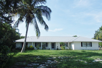 Home for Sale at 8344 SE Woodmere Street, Hobe Sound FL 33455