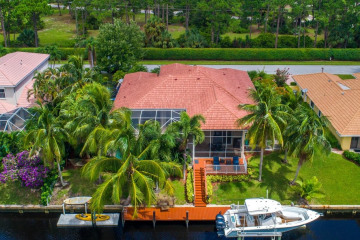 Home for Sale at 8818 SE North Passage Way, Tequesta FL 33469