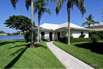 Home for Sale at 11647 Lost Tree Way #COTTAGE #24, North Palm Beach FL 33408