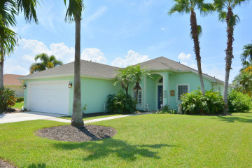 Home for Sale at 420 NW Emilia Way, Jensen Beach FL 34957