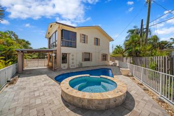 Home for Sale at 391 Neptune Road, Juno Beach FL 33408