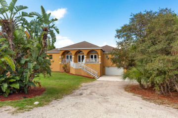 Home for Sale at 12874 SE Hobe Hills Drive, Hobe Sound FL 33455