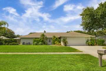 Home for Sale at 19823 Hibiscus Drive, Jupiter FL 33469