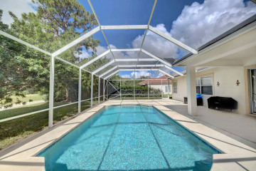 Home for Sale at 4754 SW Hammock Creek Drive, Palm City FL 34990