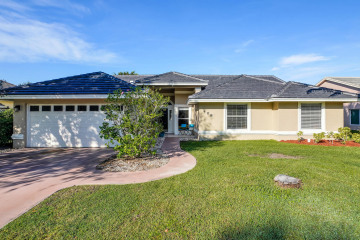 Home for Sale at 408 SW Redwood Cove, Port Saint Lucie FL 34986