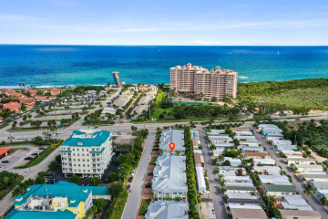 Home for Sale at 118 Ocean Breeze Drive, Juno Beach FL 33408
