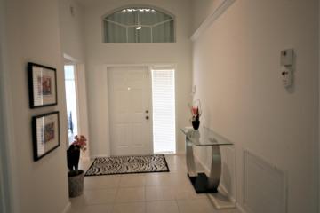 Home for Sale at 5867 Royal Isles Boulevard, Boynton Beach FL 33437
