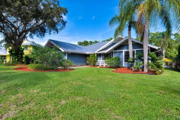 Home for Sale at 10510 SE Jupiter Narrows Drive, Hobe Sound FL 33455