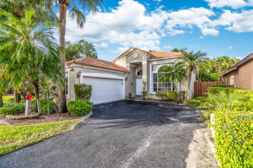 Home for Sale at 6225 NW 77th Place, Parkland FL 33067