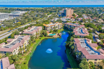Home for Sale at 400 Uno Lago Drive #201, Juno Beach FL 33408