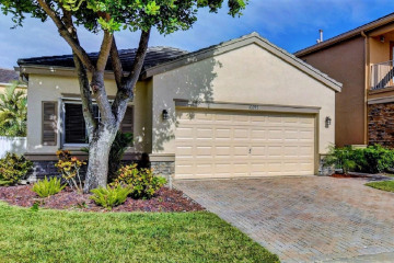 Home for Sale at 10297 Olde Clydesdale Circle, Wellington FL 33449