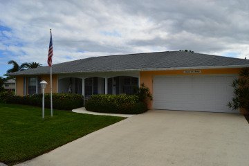 Home for Sale at 9620 SE Little Club Way N, Tequesta FL 33469