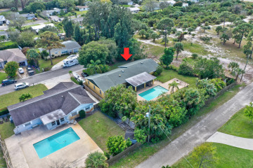 Home for Sale at 9005 SE Bobwhite Street, Hobe Sound FL 33455