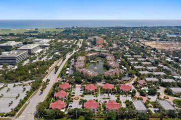 Home for Sale at 25 Uno Lago Drive, Juno Beach FL 33408