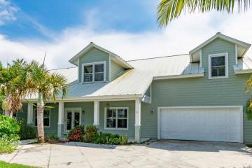 Home for Sale at 8389 SE Woodcrest Place, Hobe Sound FL 33455