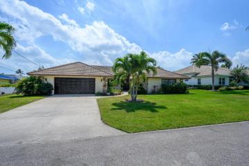 Home for Sale at 8518 SE Coconut Street, Hobe Sound FL 33455