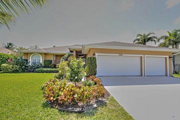 Home for Sale at 9618 SE Sharon Street, Hobe Sound FL 33455